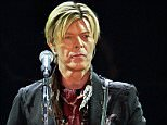 """(Files) In this file picture taken on October 20, 2003, British rock legend David Bowie performs on stage at the Bercy stadium in Paris, France. British rock icon David Bowie on Friday took another dive into the space theme that has run throughout his career, releasing """"Blackstar"""", the first single from his album of the same name. The single is being used as the opening title song to the television crime series """"The Last Panthers"""", currently being shown in Britain and France, Bowie's first foray into television music in two decades. AFP PHOTO / BERTRAND GUAYBERTRAND GUAY/AFP/Getty Images"""