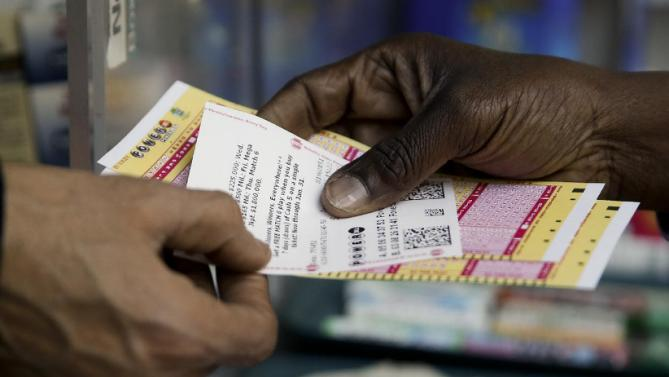 A person purchase Powerball lottery tickets from a newsstand Wednesday, Jan. 6, 2016, in Philadelphia. Players will have a chance Wednesday night at the biggest lottery prize in nearly a year.  (AP Photo/Matt Rourke)