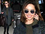 """Los Angeles, CA - """"Game of Thrones"""" star Emilia Clarke smiles for the cameras as she arrives at LAX ahead of the Golden Globe Awards weekend.  Emilia chatted on her cell phone while her greeter escorted her out to her waiting limo. AKM-GSI      January  8, 2016 To License These Photos, Please Contact : Steve Ginsburg (310) 505-8447 (323) 423-9397 steve@akmgsi.com sales@akmgsi.com or Maria Buda (917) 242-1505 mbuda@akmgsi.com ginsburgspalyinc@gmail.com"""
