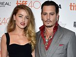 """TORONTO, ON - SEPTEMBER 14:  Actress Amber Heard (L) and actor Johnny Depp attend the """"Black Mass"""" premiere during the 2015 Toronto International Film Festival at The Elgin on September 14, 2015 in Toronto, Canada.  (Photo by George Pimentel/WireImage)"""
