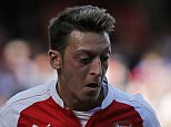 """Arsenal's German midfielder Mesut Ozil runs with the ball during the English Premier League football match between Arsenal and Stoke City at the Emirates Stadium in London on September 12, 2015.  AFP PHOTO / ADRIAN DENNIS RESTRICTED TO EDITORIAL USE. No use with unauthorised audio, video, data, fixture lists, club/league logos or """"live"""" services. Online in-match use limited to 45 images, no video emulation. No use in betting, games or single club/league/player publications.ADRIAN DENNIS/AFP/Getty Images"""