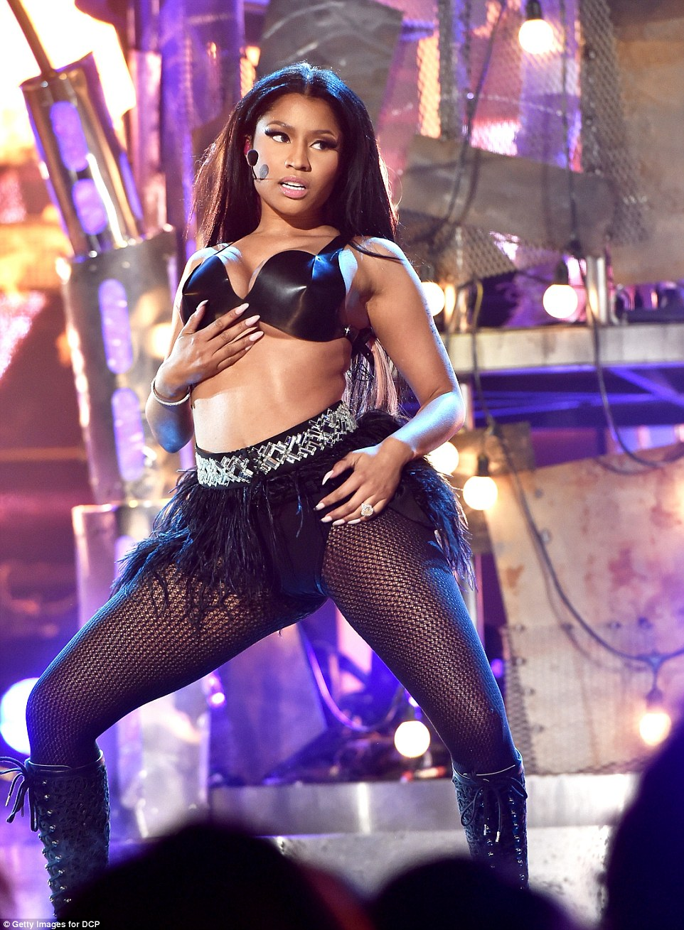 Getting down: Nicki Minaj gave a raunchy performance of The Night Is Still Young with David Guetta