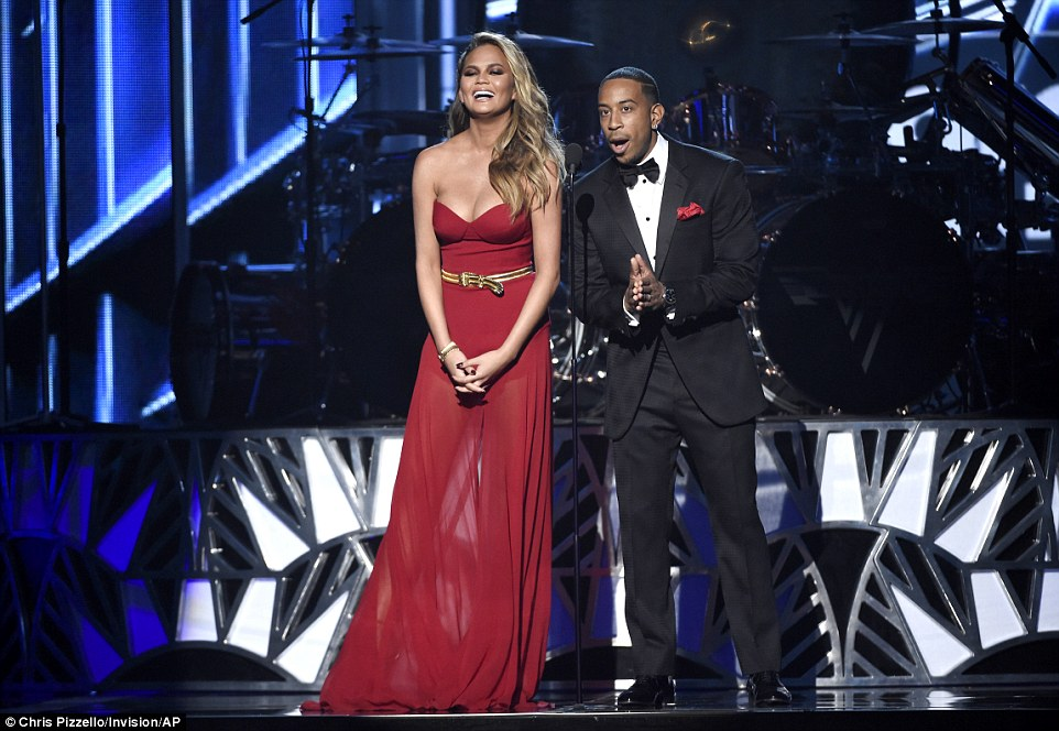 Banter: Teigen asked if she had pronounced the name of a performer correctly, 'No it's Minaj,' Ludacris corrected before the model shot back slyly, 'No I can't do those anymore'