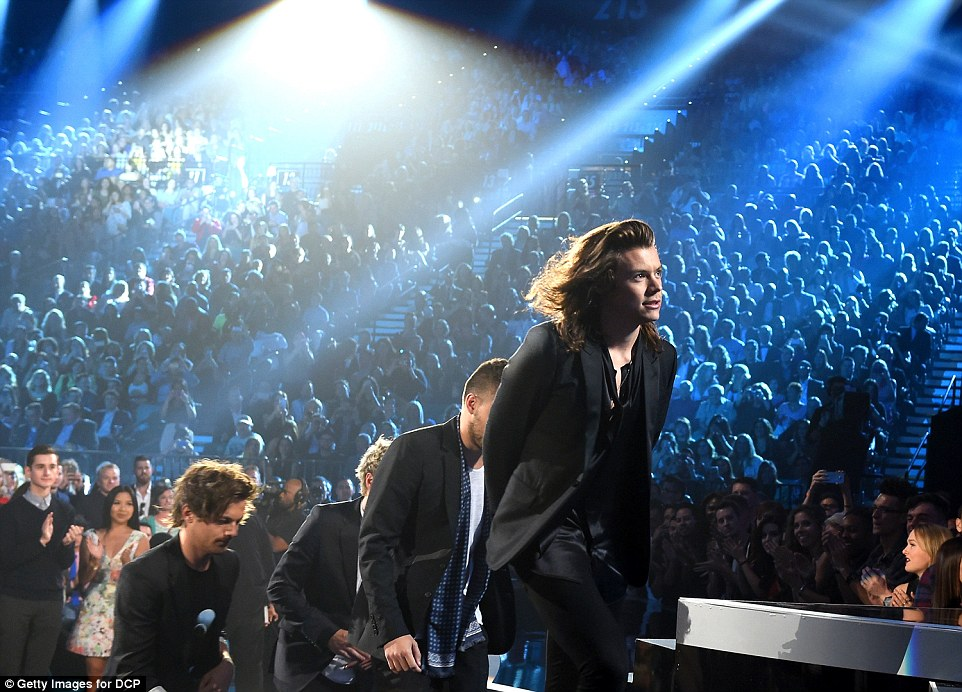 Walk of fame: One Direction took the stage again to accept the award for Top Touring Artist