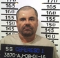 """In this Jan. 8, 2016 image released by Mexico's federal government, Mexico's most wanted drug lord, Joaquin """"El Chapo"""" Guzman, stands for his prison mug shot with the inmate number 3870 at the Altiplano maximum security federal prison in Almoloya, Mexico. Mexico has begun the process of extraditing Guzman to the United States, where he faces drug-trafficking charges, but that could take """"a year or longer"""" because of legal challenges, according to the head of Mexico's extradition office, Manuel Merino. He cited one extradition case that took six years. (Mexico's federal government via AP)"""
