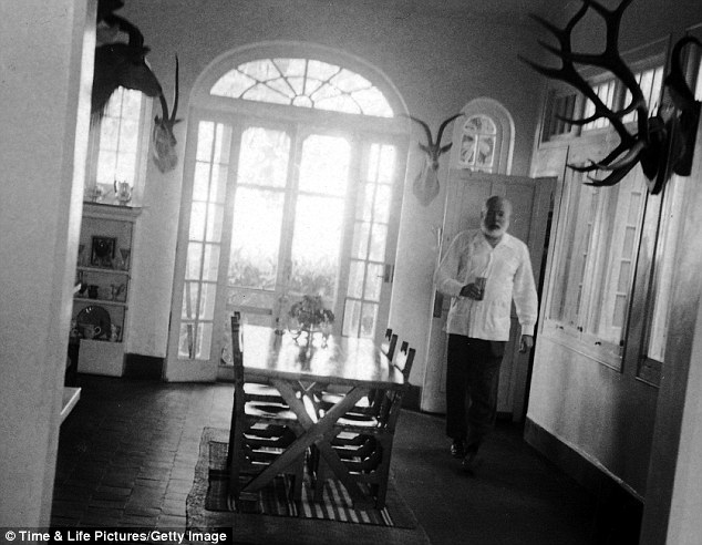 Island life: Ernest Hemingway at his home Finca Vigia in Cuba shortly after he won the Nobel Prize for The Old Man And The Sea