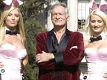 """HOLMBY HILLS, CA - MAY 6:  (L to R) Playboy bunny Sheila Levell, Playboy founder Hugh Hefner and Playboy bunny Holly Madison perform a scene during the filming of a commercial for """"X Games IX"""" at the Playboy Mansion May 6, 2003 in Holmby Hills, California. This year's X Games will take place at STAPLES Center in Los Angeles from August 14th through 18th.  (Photo by Robert Mora/Getty Images)  Playboy mansion for sale"""