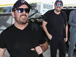 Picture Shows: Ricky Gervais  January 11, 2016\n \n Actor Ricky Gervais is seen departing on a flight at LAX airport in Los Angeles, California. Ricky was heading back to London after hosting last night's Golden Globe Awards. \n \n Non-Exclusive\n UK RIGHTS ONLY\n \n Pictures by : FameFlynet UK © 2016\n Tel : +44 (0)20 3551 5049\n Email : info@fameflynet.uk.com