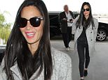 Monday, January 11, 2016 - Olivia Munn at Los Angeles International Airpor signing autographs and catching a flight. /X17online.com