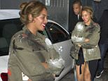EXCLUSIVE: ** PREMIUM EXCLUSIVE RATES APPLY** Power couple, Beyonce and Jay Z  appear to be covering up a possible Baby Bump and her and Jay Z were seen leaving the back door of 'Son-of-a-Gun' Restaurant in Los Angeles, CA. Beyonce was looking much fuller in the stomach region as the large jacket she was wearing was being highly held together as she laughed and smiled while leaving dinner.\n\nPictured: Beyonce, Jay Z\nRef: SPL1192775  110116   EXCLUSIVE\nPicture by: SPW / Splash News\n\nSplash News and Pictures\nLos Angeles: 310-821-2666\nNew York: 212-619-2666\nLondon: 870-934-2666\nphotodesk@splashnews.com\n