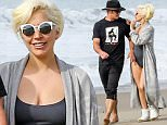 *PREMIUM EXCLUSIVE* *SHOT ON 1/11/16* Malibu, CA - Actor Taylor Kinney and fiance Lady Gaga hold hands as they go for a romantic walk on the beach.  The cute couple held hands and looked to be in their own world.  Gaga looked super sexy in a grey one-piece bathing suit with white Ugg boots and a oversized shawl.\n \nAKM-GSI    January  12, 2016\n*PREMIUM EXCLUSIVE*\nTo License These Photos, Please Contact :\nSteve Ginsburg\n(310) 505-8447\n(323) 423-9397\nsteve@akmgsi.com\nsales@akmgsi.com\nor\nMaria Buda\n(917) 242-1505\nmbuda@akmgsi.com\nginsburgspalyinc@gmail.com