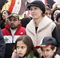 In support: Asma (right), the wife of Syrian President Bashar al-Assad, made an appearance with her two children, seven-year-old Karim (right) and nine-year-old Zein (left)