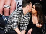 LOS ANGELES, CA - JANUARY 05:  Lea Michele (R) and Matthew Paetz kiss at a basketball game between the Golden State Warriors and the Los Angeles Lakers at Staples Center on January 5, 2016 in Los Angeles, California.  (Photo by Noel Vasquez/GC Images)