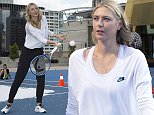 Australian Open 2016.Maria Sharapova does a promotional gig on s snow covered court on Crown Towers rooftop.  She had a hit with some kids on the court covered in fake snow with a snow machine blowing more fake snow in the air