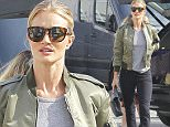 Exclusive... 51947635 Newly engaged model/actress Rosie Huntington-Whiteley hides her ring inside of her jacket as she shops at Yves Saint Laurent in Beverly Hills, California on January 14, 2016. It is being reported that Jason Statham proposed to his longtime girlfriend with a gorgeous 5-carat Neil Lane¿designed ring which cost $350,000! FameFlynet, Inc - Beverly Hills, CA, USA - +1 (310) 505-9876