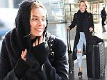 14 Jan 2016 - NEW YORK - USA  MARGOT ROBBIE ARRIVES AT JFK AIRPORT IN NYC.   BYLINE MUST READ : XPOSUREPHOTOS.COM  ***UK CLIENTS - PICTURES CONTAINING CHILDREN PLEASE PIXELATE FACE PRIOR TO PUBLICATION ***  **UK CLIENTS MUST CALL PRIOR TO TV OR ONLINE USAGE PLEASE TELEPHONE  44 208 344 2007 ***