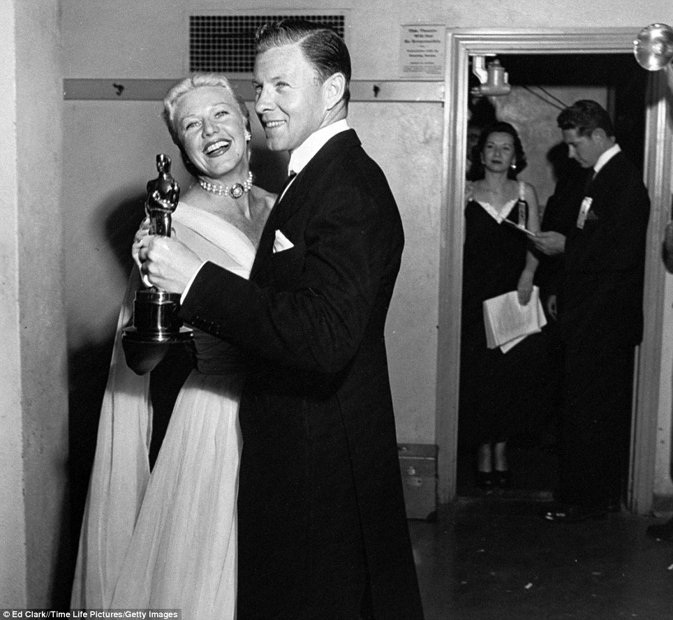 Dancing with the real stars: Ginger Rogers and George Murphy take a spin holding the Oscar which they presented at the 22nd awards ceremony in 1950