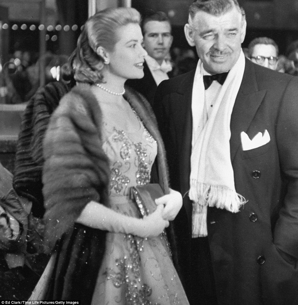 The golden age: Clark Gable arrives with Grace Kelly at the 26th annual Academy presentation at the RKO Pantages theater, Hollywood