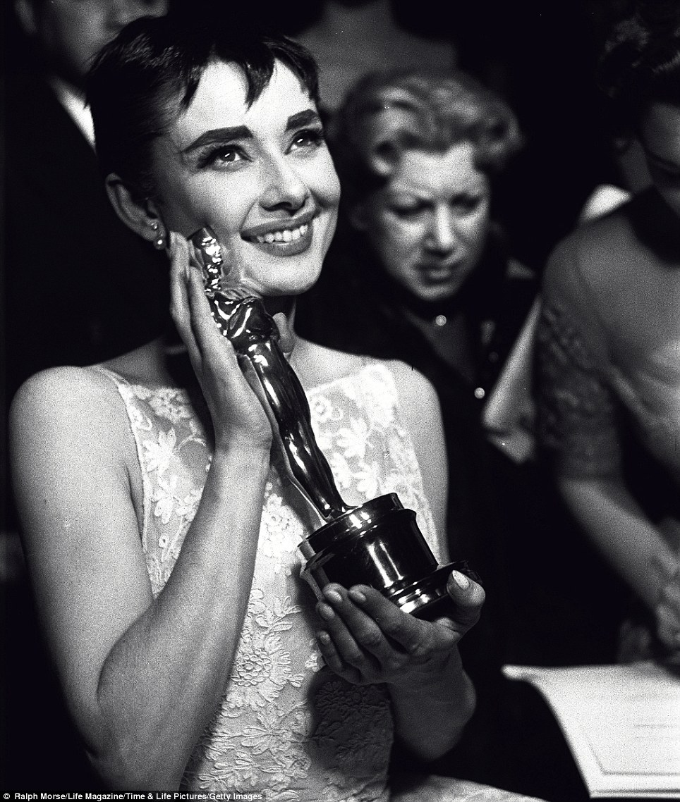 Better than box from Tiffany's: Audrey Hepburn beams and clutches her Oscar for best actress at the ceremony in Hollywood, 1953 after her performance in Roman Holiday