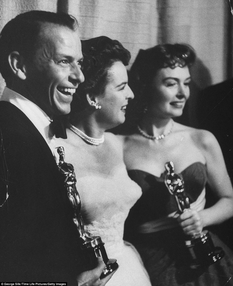 The best is yet to come: Frank Sinatra and Donna Reed (pictured right) hold their best supporting Oscars while posing with presenter Mercedes McCambridge (centre) for the movie From Here to Eternity at the 26th Annual Academy Awards Ceremony