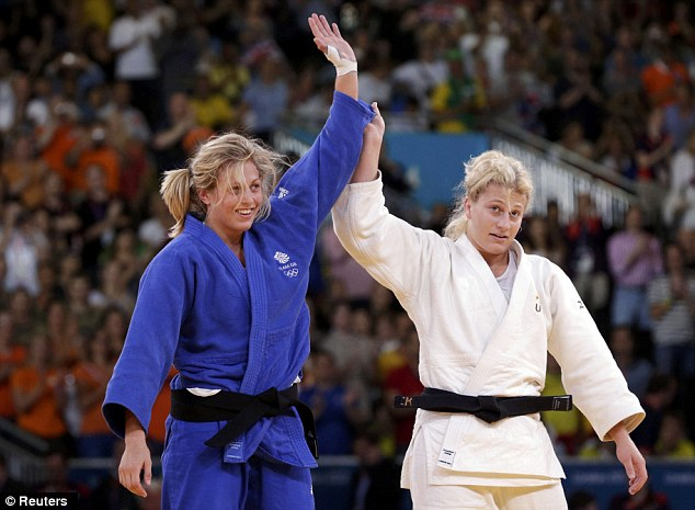 All over: Kayla Harrison and Gemma Gibbons (left) at the end of their final