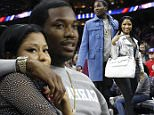 Nicki Minaj, right, and Meek Mill, left, watch action from the sidelines during the first half of an NBA basketball game between the Portland Trail Blazers and the Philadelphia 76ers, Saturday, Jan. 16, 2016, in Philadelphia. (AP Photo/Chris Szagola)