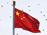 Released balloons fly around the Flag of China during a military parade marking the 70th Anniversary of the 'Victory of Chinese People's Resistance against Japanese Aggression and World Anti-Fascist War' at Tiananmen Square on September 3, 2015 in Beijing, China.   China is marking the 70th anniversary of the end of World War II and its role in defeating Japan with a new national holiday and a military parade in Beijing.   BEIJING, CHINA - SEPTEMBER 03: (Photo by Rolex Dela Pena - Pool/Getty Images)