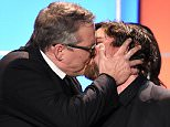 SANTA MONICA, CA - JANUARY 17:  Director Adam McKay (L) and actor Christian Bale kiss onstage as they accept the Best Comedy award for 'The Big Short' during the 21st Annual Critics' Choice Awards at Barker Hangar on January 17, 2016 in Santa Monica, California.  (Photo by Kevin Winter/Getty Images)