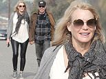 EXCLUSIVE TO INF.\nJanuary 17, 2016: Neil Young and Daryl Hannah go for a romantic stroll in Malibu. The pair were holding hands and couldn't seem to stop smiling.\nMandatory Credit: Borisio/INFphoto.com Ref: infusla-277