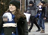 Pic shows: Keira Knightley and husband James Righton wrap their daughter Edie up warm in a forward facing baby carrier as they strolled though London today on a shopping trip.\\n\\nThe happy couple held hands wearing matching black woolly hats.\\nKeira wore a fur lined leather jacket and boots\\n\\n\\n\\n\\nPic by Gavin Rodgers/Pixel 8000 Ltd