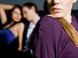 A stock photo of a woman feeling jealousy about a couple.  BKY12E jealousy