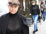 Ellen Pompeo  lets it hang out weaing a see through shirt showing bra in Los Angeles.   Monday, January 18, 2016. X17online.com