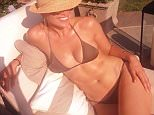 """EROTEME.CO.UK\nFOR UK SALES: Contact Caroline 44 207 431 1598 \nFrom Twitter, Instagram, and Facebook, celebrities share their private lives and thoughts with the public.\n\nPicture shows: Jennifer Lopez showing off her stunning bikini body in a simple, dark colored swimsuit and sunhat as she laughs while hanging out with pal Leah Remini in a sexy recent pic she shared on social media. Jennifer says: ìShe yelled at me """"DONT MOVE!"""" Another shot by Remini... #shemakesmelaugh #notmad #loca #loveher #shesgettinggoodatthisî\n\nNON-EXCLUSIVE     August 10, 2014\nJob: 140810B1 Hollywood, CA USA\nEROTEME.CO.UK\n44 207 431 1598\n\nDisclaimer note of Eroteme.co.uk: Eroteme Ltd does not claim copyright for this image. This image is merely a supply image and payment will be on supply/usage fee only."""