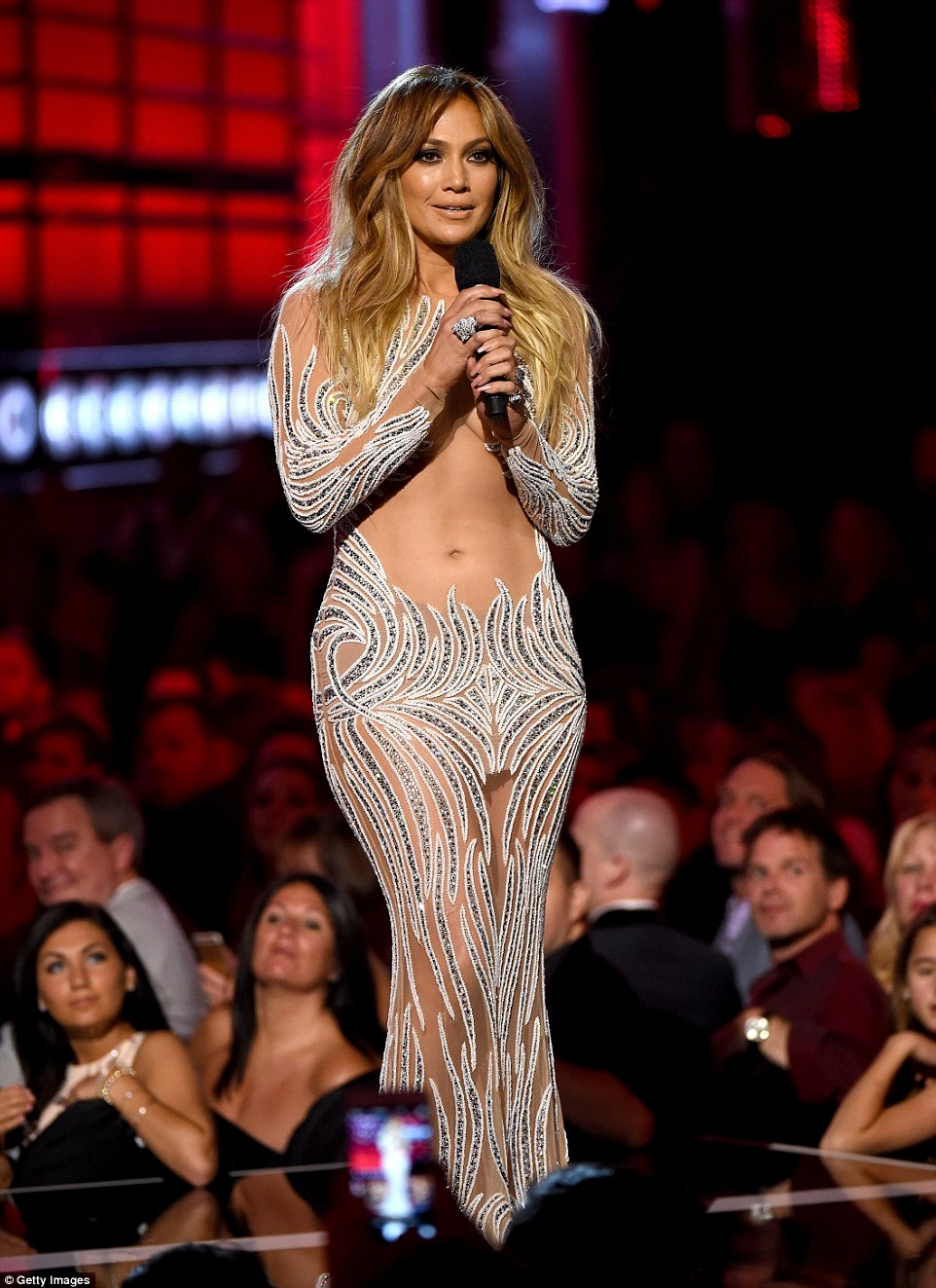 Smoking hot! Jennifer Lopez played presenter in a sheer outfit