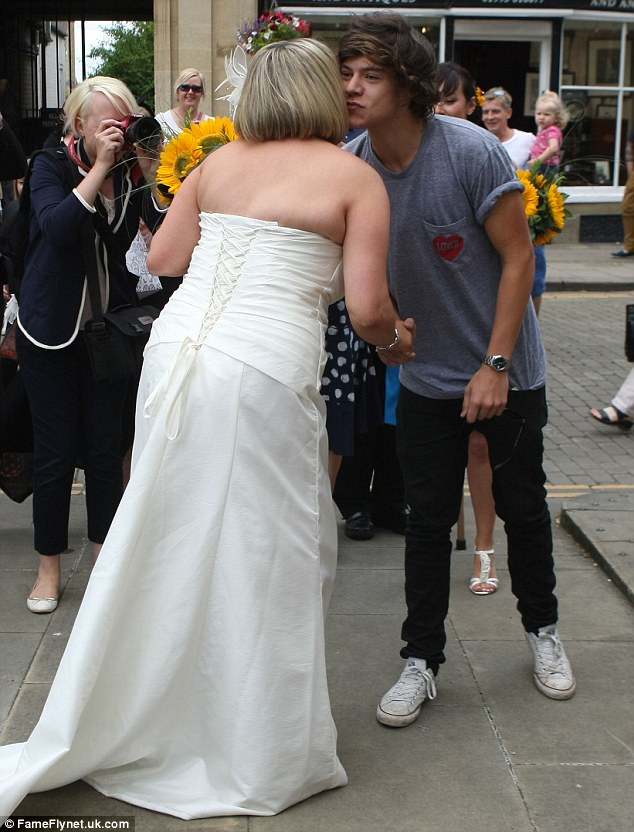 Even brides aren't safe! One Direction lothario Harry Styles stopped to give a newlywed a cheeky kiss when he bumped into her on the street in Oxford