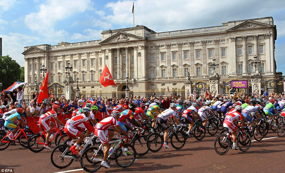 Cyclists pedal in front of Buckingham Palace during the Men's Road Cycling Race at the London 2012 Olympic Games in London