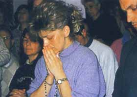 Mirjana praying before her