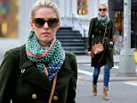 TV personality Nicky Hilton, wearing a rainbow purse, lace-up ankle boots, jeans, colorful scarf and dark green wool jacket, Rothschild walks to Soho in New York City on January 20, 2016.\n\nPictured: Nicky Hilton Rothschild\nRef: SPL1212179  200116  \nPicture by: Christopher Peterson/Splash News\n\nSplash News and Pictures\nLos Angeles: 310-821-2666\nNew York: 212-619-2666\nLondon: 870-934-2666\nphotodesk@splashnews.com\n