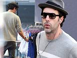 15.JAN.2015 - LOS ANGELES - USA\n***EXCLUSIVE ALL ROUND PICTURES***\n*** STRICTLY AVAILABLE FOR UK AND GERMANY USE ONLY ***\nActor Sacha Baron Cohen tries to keep a low profile while going to shop at Hustler on Sunset for some sexy lingerie. The funny man is seen fingering through some corsets and then happily whistling down the street seemingly happy with his new purchase.  Perhaps Sacha is buying wife Isla Fisher a sexy early birthday present.\nBYLINE MUST READ : AKM-GSI-XPOSURE\n***UK CLIENTS - PICTURES CONTAINING CHILDREN PLEASE PIXELATE FACE PRIOR TO PUBLICATION***\n*UK CLIENTS MUST CALL PRIOR TO TV OR ONLINE USAGE PLEASE TELEPHONE 0208 344 2007*