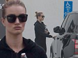 EXCLUSIVE. Coleman-Rayner. Los Angeles, CA, USA.\nJanuary 19, 2016 \nRosie Huntington-Whiteley leaves her luxury car parked in a disabled parking spot while going to workout at the gym. The Victoria's Secret model and fiancee of actor Jason Statham was clad in an all black ensemble as she flashed her $350,000 engagement ring following news of the couple's engagement.\nCREDIT LINE MUST READ: Coleman-Rayner\nTel US (001) 310 474 4343 - office \nTel US (001) 323 545 7584 - cell\nwww.coleman-rayner.com
