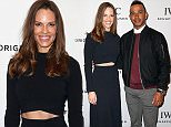 GENEVA, SWITZERLAND - JANUARY 19: Hilary Swank and Lewis Hamilton visit the IWC booth during the launch of the Pilot's Watches Novelties from the Swiss luxury watch manufacturer IWC Schaffhausen at the Salon International de la Haute Horlogerie (SIHH) 2016 on January 19, 2016 in Geneva, Switzerland.  (Photo by Chris Jackson/Getty Images for IWC)