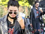 Kendall Jenner is into heavy metal? The sexy model steps out in black leather and skin tight yoga pants as she hits Alfred's for coffee. Beneath her leather she's wearing a t-shirt of the heavy metal band Slayer. January 20, 2016 X17online.com