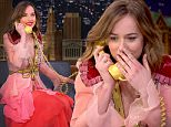 """THE TONIGHT SHOW STARRING JIMMY FALLON -- Episode 0404 -- Pictured: (l-r) Actress Dakota Johnson plays """"The Acting Game"""" with host Jimmy Fallon on January 20, 2016 -- (Photo by: Andrew Lipovsky/NBC/NBCU Photo Bank via Getty Images)"""