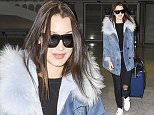 21.JAN.2016 - PARIS - FRANCE Model Bella Hadid arrives at Charles de Gaulle airport in Paris, France! BYLINE MUST READ : E-PRESS / XPOSUREPHOTOS.COM *AVAILABLE FOR UK SALE ONLY* ***UK CLIENTS - PICTURES CONTAINING CHILDREN PLEASE PIXELATE FACE PRIOR TO PUBLICATION ****** **UK CLIENTS MUST CALL PRIOR TO TV OR ONLINE USAGE PLEASE TELEPHONE  44 208 344 2007 ***