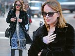 Dakota Johnson wears a fur coat over a dress while out and about in New York City.\n\nPictured: Dakota Johnson\nRef: SPL1213019  210116  \nPicture by: Turgeon-Steffman / Splash News\n\nSplash News and Pictures\nLos Angeles: 310-821-2666\nNew York: 212-619-2666\nLondon: 870-934-2666\nphotodesk@splashnews.com\n