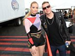 LAS VEGAS, NV - SEPTEMBER 20:  Rappers Iggy Azalea (L) and Macklemore attend the 2014 iHeartRadio Music Festival Village on September 20, 2014 in Las Vegas, Nevada.  (Photo by Jeff Kravitz/FilmMagic)