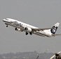LOS ANGELES, CA - APRIL 22:  An Alaska Airlines jet passes the air traffic control tower at Los Angles International Airport (LAX) during take-off on April 22, 2013 in Los Angeles, California. Delays have been reported throughout the nation because of the furloughing of air traffic controllers under sequestration. The average delay overnight in the Southern California Terminal Radius Approach Control (TRACON) was was three hours.  (Photo by David McNew/Getty Images)