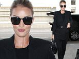 Picture Shows: Rosie Huntington-Whiteley  January 22, 2016\n \n Model and actress Rosie Huntington-Whiteley departs from LAX airport in Los Angeles. Absent was her actor boyfriend, Jason Statham.\n \n Non-Exclusive\n UK RIGHTS ONLY\n \n Pictures by : FameFlynet UK © 2016\n Tel : +44 (0)20 3551 5049\n Email : info@fameflynet.uk.com
