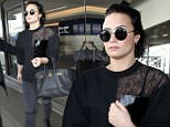 Los Angeles, CA - Demi Lovato arrives at LAX rocking an all black outfit but not a smile. She's seen with a straight face walking to her car. \n  \nAKM-GSI      January 22, 2016\nTo License These Photos, Please Contact :\nSteve Ginsburg\n(310) 505-8447\n(323) 423-9397\nsteve@akmgsi.com\nsales@akmgsi.com\nor\nMaria Buda\n(917) 242-1505\nmbuda@akmgsi.com\nginsburgspalyinc@gmail.com