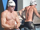 Picture Shows: Zac Efron  January 21, 2016\n \n ***NO WEB USE W/O PRIOR AGREEMENT - CALL FAMEFLYNET USA FOR PRICING***\n \n American actor Zac Efron shows off his fit physique while enjoying a swimming class in Los Angeles, California. \n \n After the class, Zac stopped to snap a photo with an adoring fan.\n \n ***NO WEB USE W/O PRIOR AGREEMENT - CALL FAMEFLYNET USA FOR PRICING***\n \n Exclusive\n UK RIGHTS ONLY\n Pictures by : FameFlynet UK � 2016\n Tel : +44 (0)20 3551 5049\n Email : info@fameflynet.uk.com